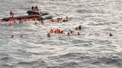 Shipwrecked migrants await rescue in the Mediterranean Sea on 11 November 2020