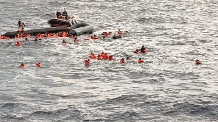 Migrants at sea waiting to be rescued by Spanish search and rescue ship Open Arms