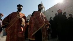 Orthodox clergy attend Christmas celebrations at the Church of the Nativity in Bethlehem