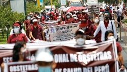 Health workers march while going on an indefinite strike as they demand a better national health budget and access to vaccines, in Lima, Peru