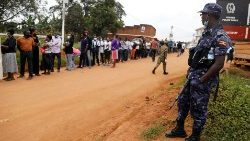 Voters queue to cast their ballots in the presidential elections in Uganda