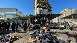 Site of a suicide attack in a central market in Baghdad