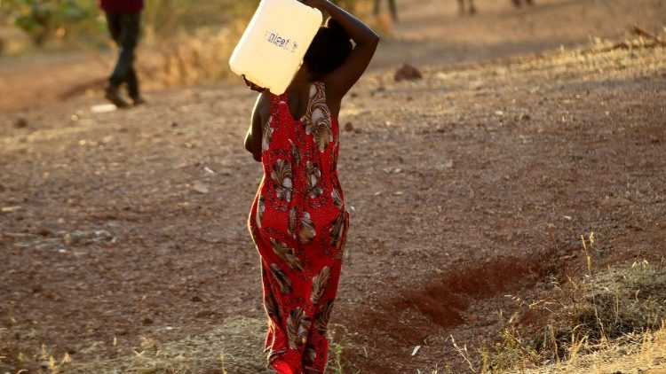 A woman fleeing violence in Tigray walks in a camp on the Sudan-Ethiopia border