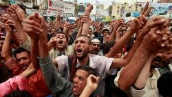 FILE PHOTO: Anti-government protesters attend a rally in 2011 in Sanaa