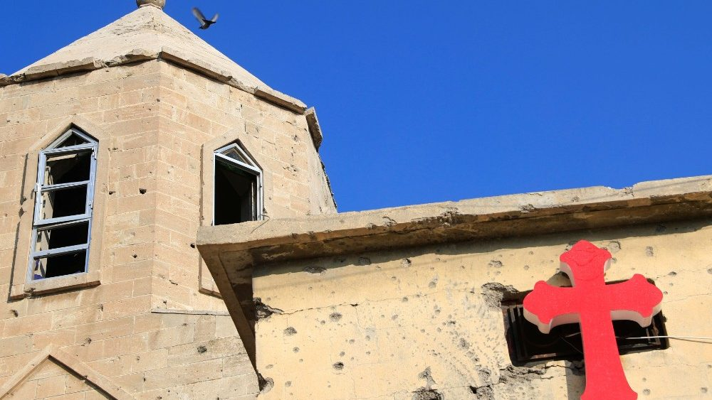 A cross is pictured at the wall of a church in the old city of Mosul