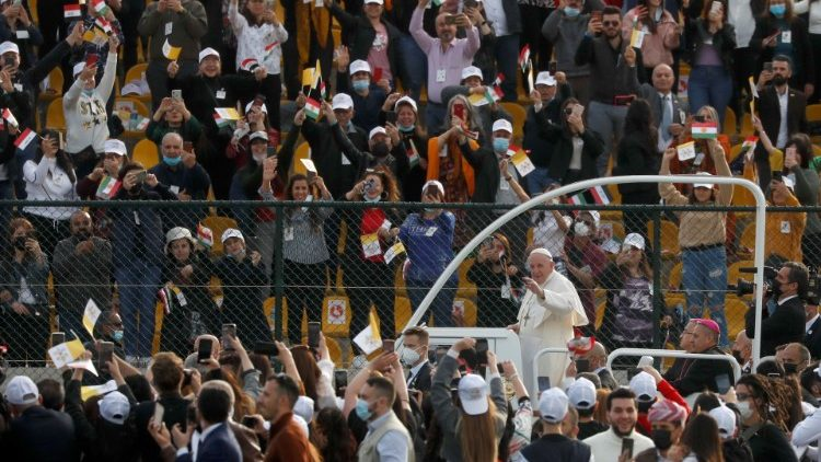 "Pope Francis arrives to hold a Mass at the ""Franso Hariri"" stadium in Erbil, Iraq on Sunday"