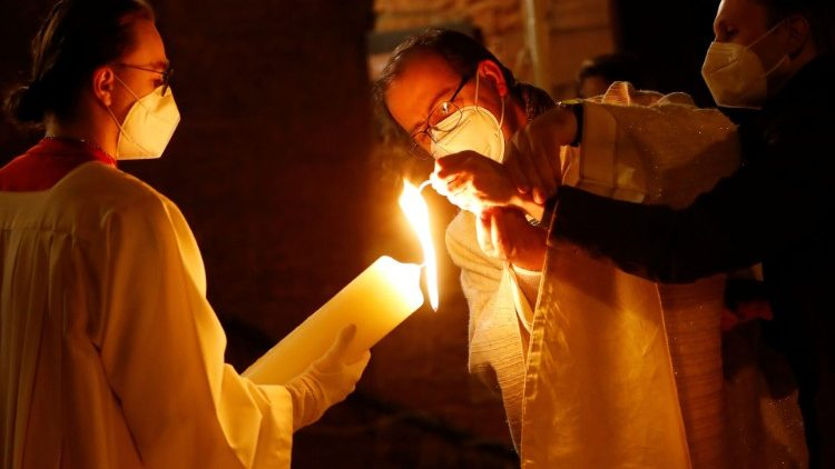 A priest in Germany lights an Easter candle