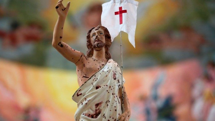 A statue of the Risen Christ, splattered with blood from a bomb attack in Sri Lanka in 2019