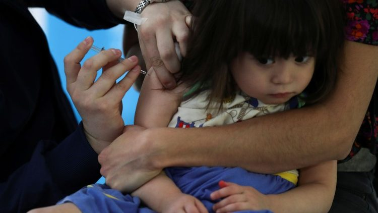 A child receiving a vaccine in Chile