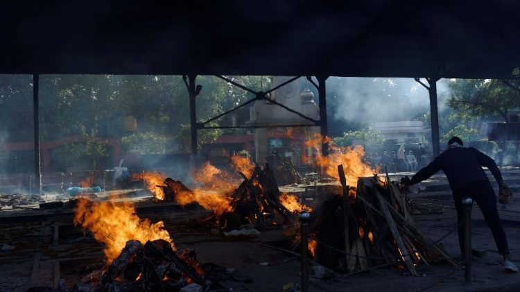 Funeral fires of those who died of Covid-19 at a crematorium in New Delhi, India.