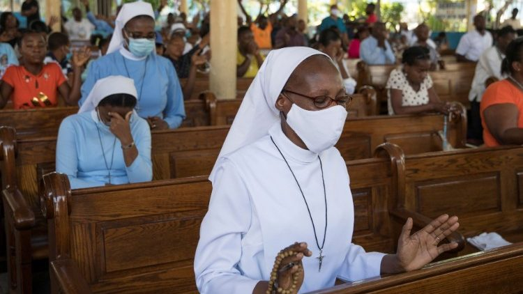 People pray against an epidemic of kidnappings sweeping Haiti amid deepening political unrest and economic misery