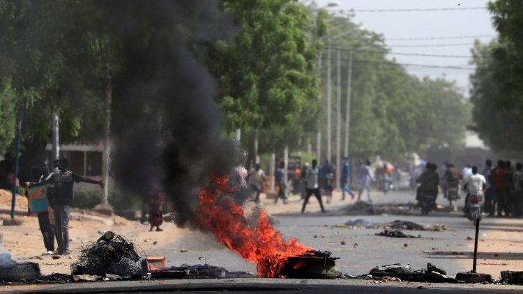 Tires burn at a barricade during protests demanding return to civilian rule in N'Djamena