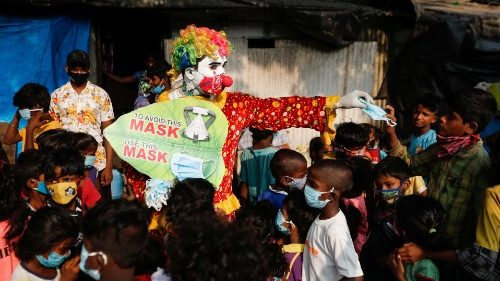 A clown raising awareness about Covid-19 among children in a slum in Mumbai, India.