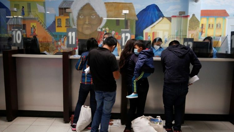 Migrant families register at a migration facility in Guatemala after being deported from the U.S. under title 42