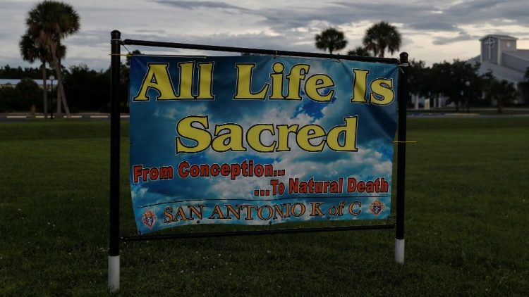 """A sign reading """"All Life Is Sacred"""" sits San Antonio Catholic Church in Port Charlotte, Florida"""