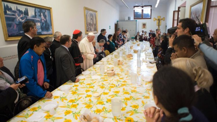 Pope Francis at lunch with the poor