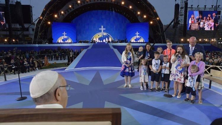 Pope Francis listens to a family giving a testimony during the Festival of Families