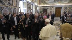 "Pope Francis meeting a group of businessmen who held a meeting on ""Laudato Si""., September 1."