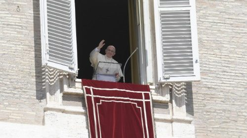 Pope Francis waves to the crowds at the Sunday Angelus