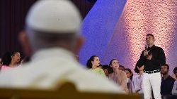 Pope Francis listens to the questions posed by young people