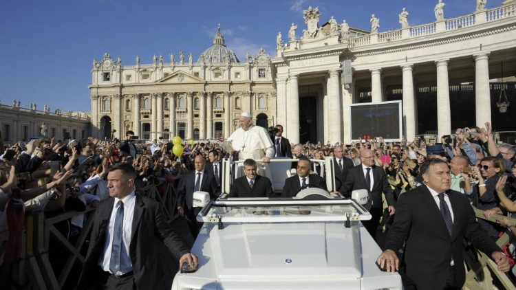 Pope Francis greets pilgrims in St Peter's square prior to the Wednesday General Audience