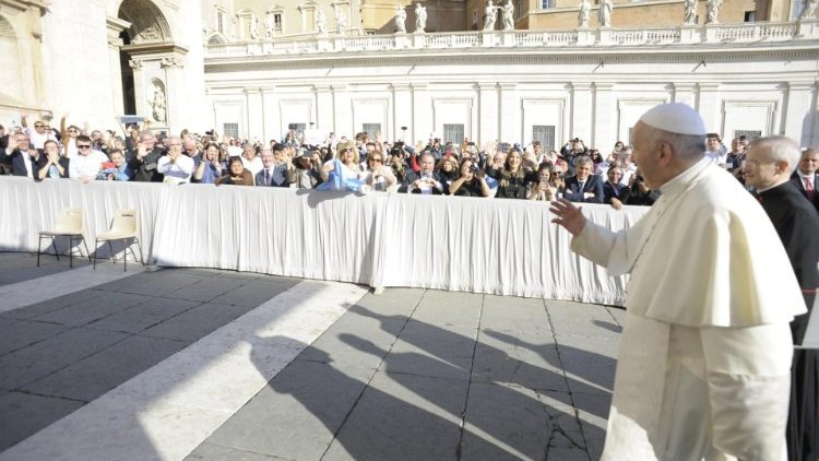 Pope Francis greets pilgrims in St Peter's Square during the weekly general audience