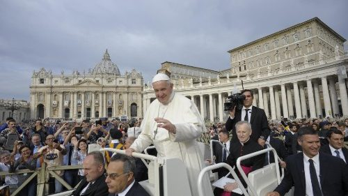 Pope Francis greets pilgrims in St Peter's Square before the weekly General Audience