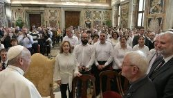 Pope Francis listens to the 'Alumni of Heaven' choir members