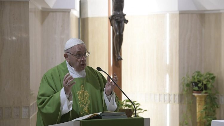 Pope Francis delivers the homily at Mass