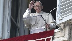 Pope Francis waves to the faithful during the Angelus on New Year's Day, the Solemnity of Mary the Mother of God