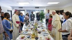 Brenda Noriega (center left, pink blouse) has lunch with Pope Francis