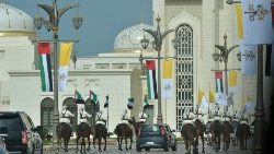 An equestrian procession accompanies Pope Francis' arrival at Presidential Palace