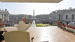 Pope Francis waves to pilgrims at the weekly General Audience