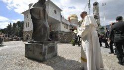 Pope Francis prays before the statue of Mother Teresa in Skopje, North Macedonia