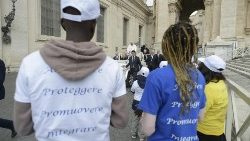 Pope Francis stops the popemobile in St. Peter's Square to invite a group of migrant children to jump in for a ride