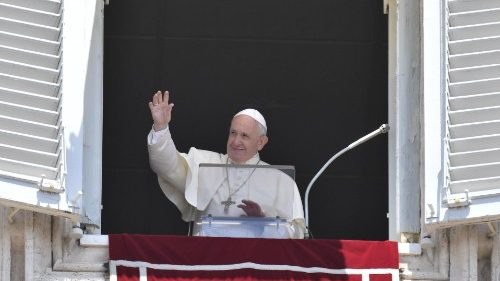 Pope Francis waves to pilgrims in St. Peter's Square