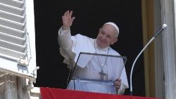 Pope Francis waves to pilgrims at the Sunday Angelus