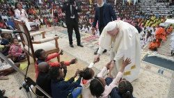 Pope Francis greets children at the Akamasoa Association