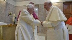 Pope Francis praying for  Pope emeritus Benedict XVI in his time of loss