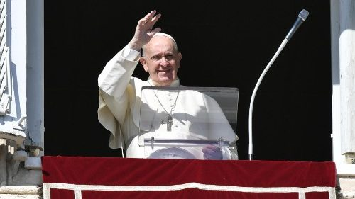 Pope Francis waves to the faithful in St. Peter's Square