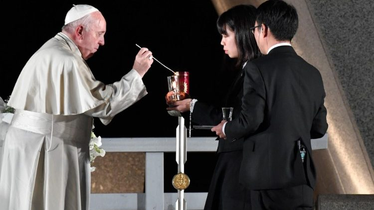 Pope Francis lights a candle at the Hiroshima Peace Memorial in Japan