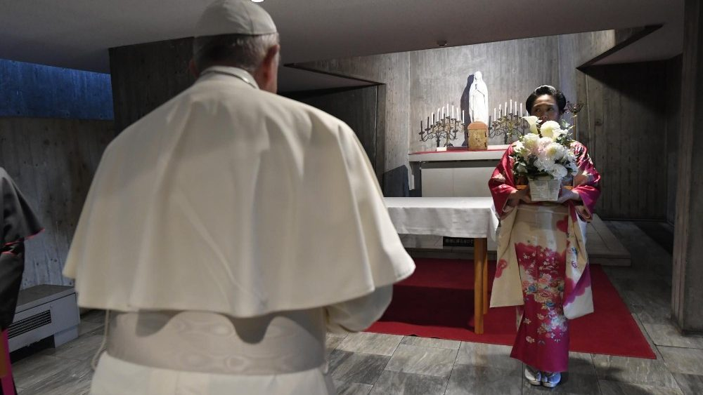 A Japanese woman greets Pope Francis at St Mary Cathedral