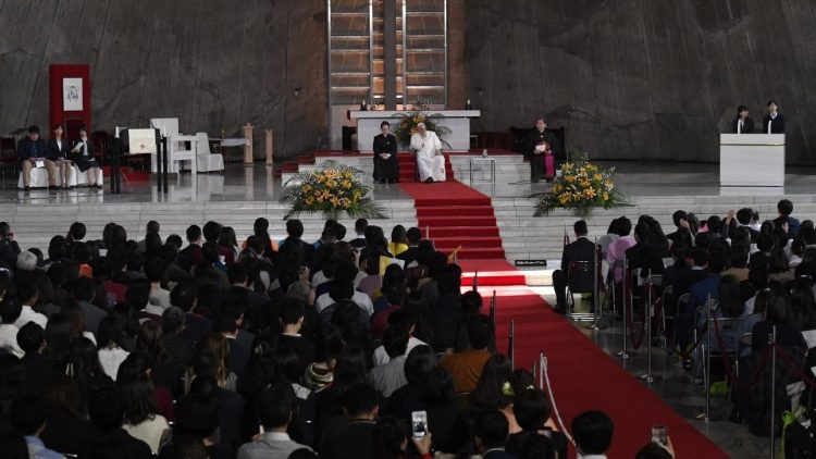 Pope Francis surrounded by young people in Tokyo's Cathedral