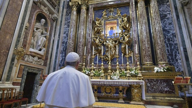 Pope Francis prays before an icon of the Virgin Mary n the Basilica of Saint Mary Major