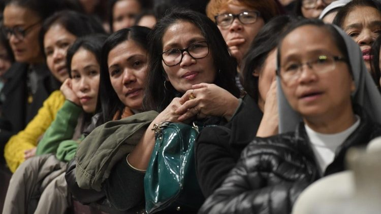 Members of the Filipino community attend Mass in St Peter's Basilica
