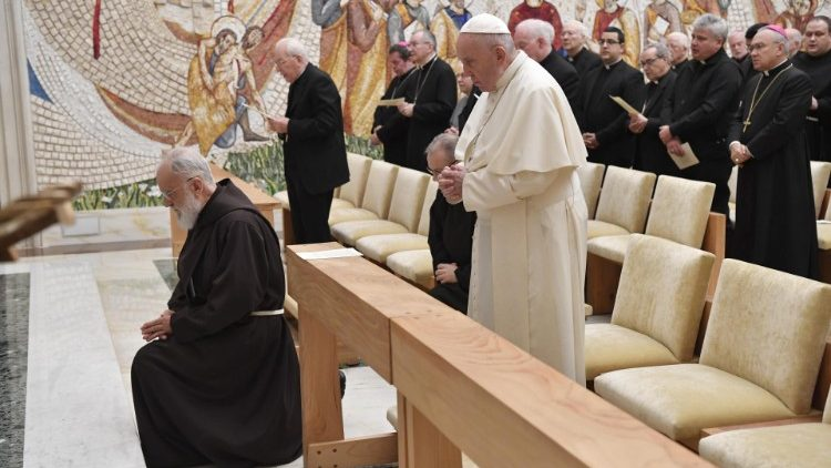 Father - now Cardinal - Cantalamessa kneels before an Advent sermon in 2019