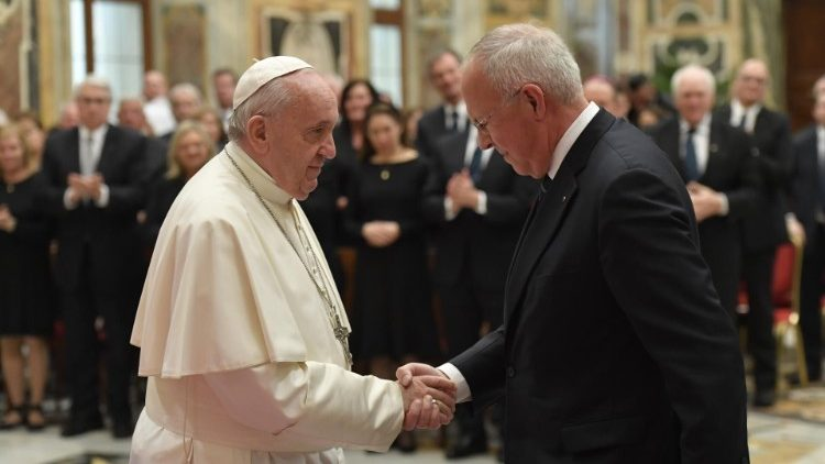 Pope Francis greets Supreme Knight Carl Anderson at the audience with members of the Knights of Columbus