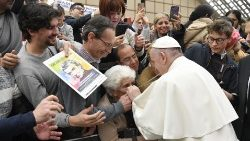 Pope Francis lets an elderly lady kiss his pectoral cross
