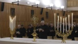 Members of the Roman Curia in adoration of the Blessed Sacrament