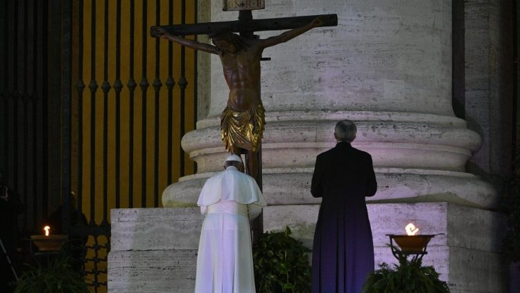 Pope Francis venerating the crucifix during the prayer on the steps of St Peter's Basilica, 27 March 2020
